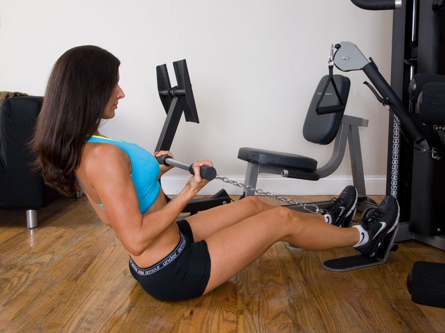 Female using the Bodycraft LGX Home Gym